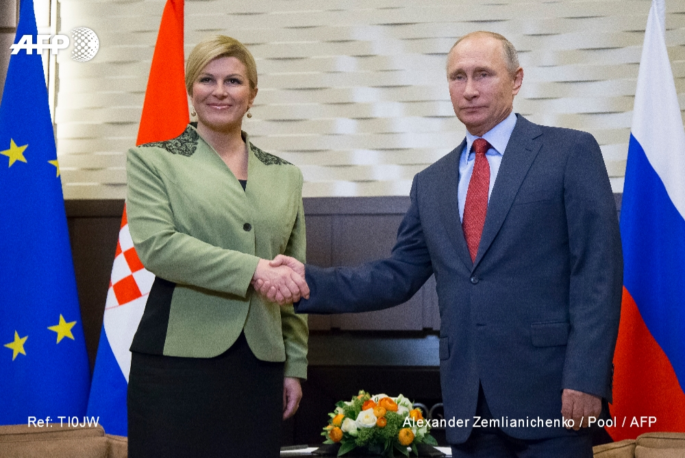 Croatian President Kolinda Grabar-Kitarovic (L) meets with Vladimir Putin on October 18, 2017 in Sotchi, Russia