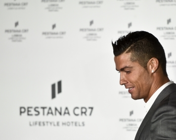 Cristiano Ronaldo arrives onstage to deliver a speech during the official inauguration of the the Pestana CR7 Lisbon Hotel in Lisbon on October 2, 2016.